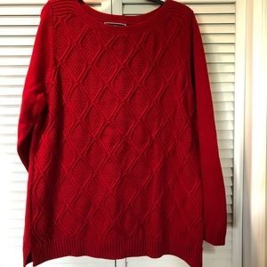 Red knit sweater with diamond pattern on front